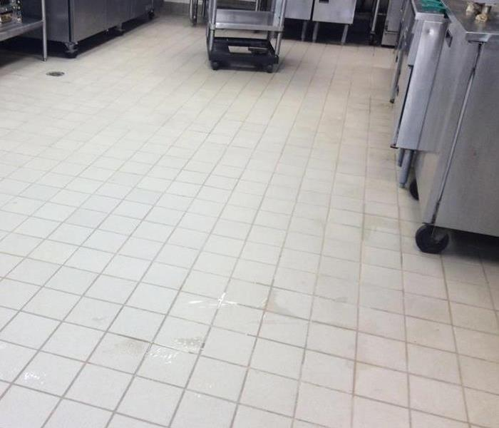 restaurant's kitchen tile floor white and clean