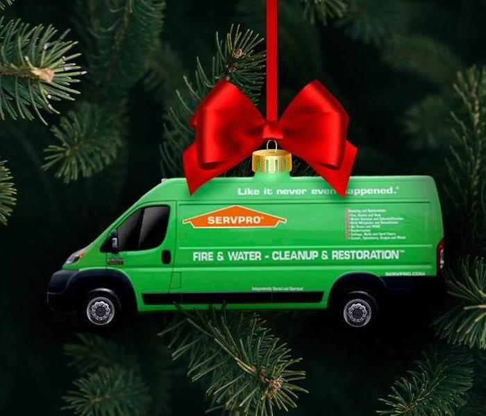 A SERVPRO van as an ornament hanging from a tree.